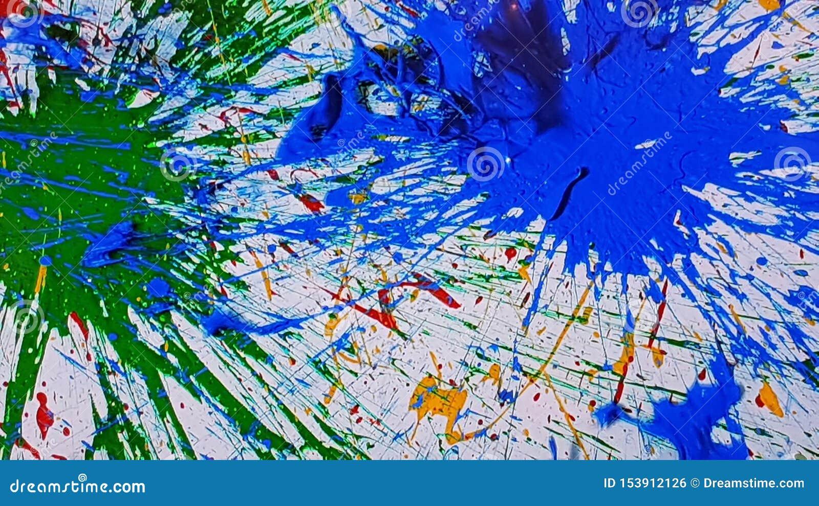 éclaboussement De La Peinture Bleu Et Vert Photo Stock