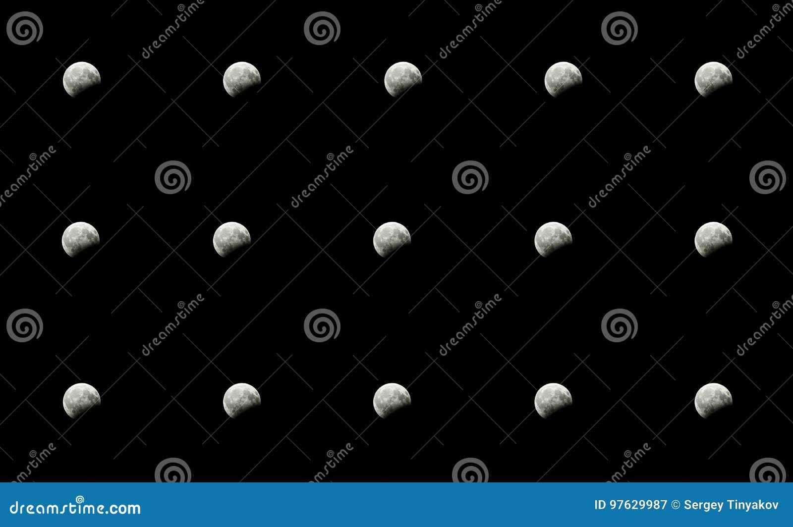 Éclipse partielle de lune dans la nuit en été