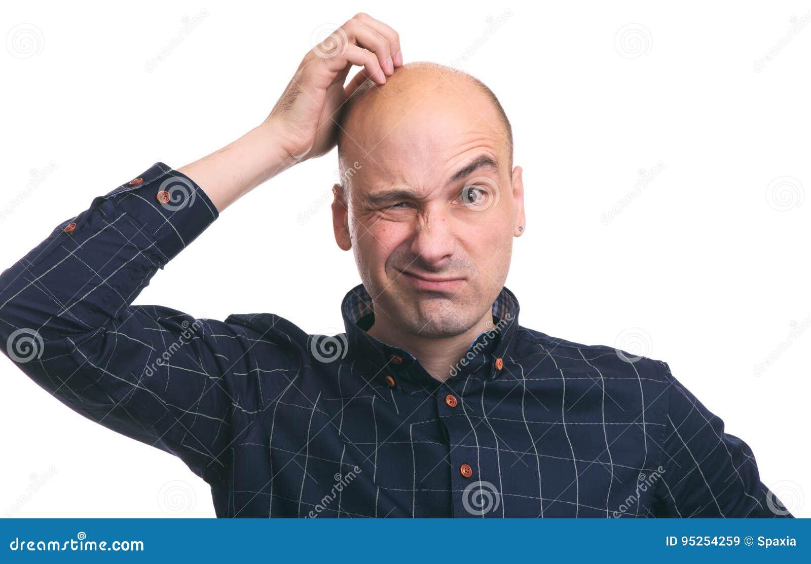 Éraflure chauve confuse de type sa tête