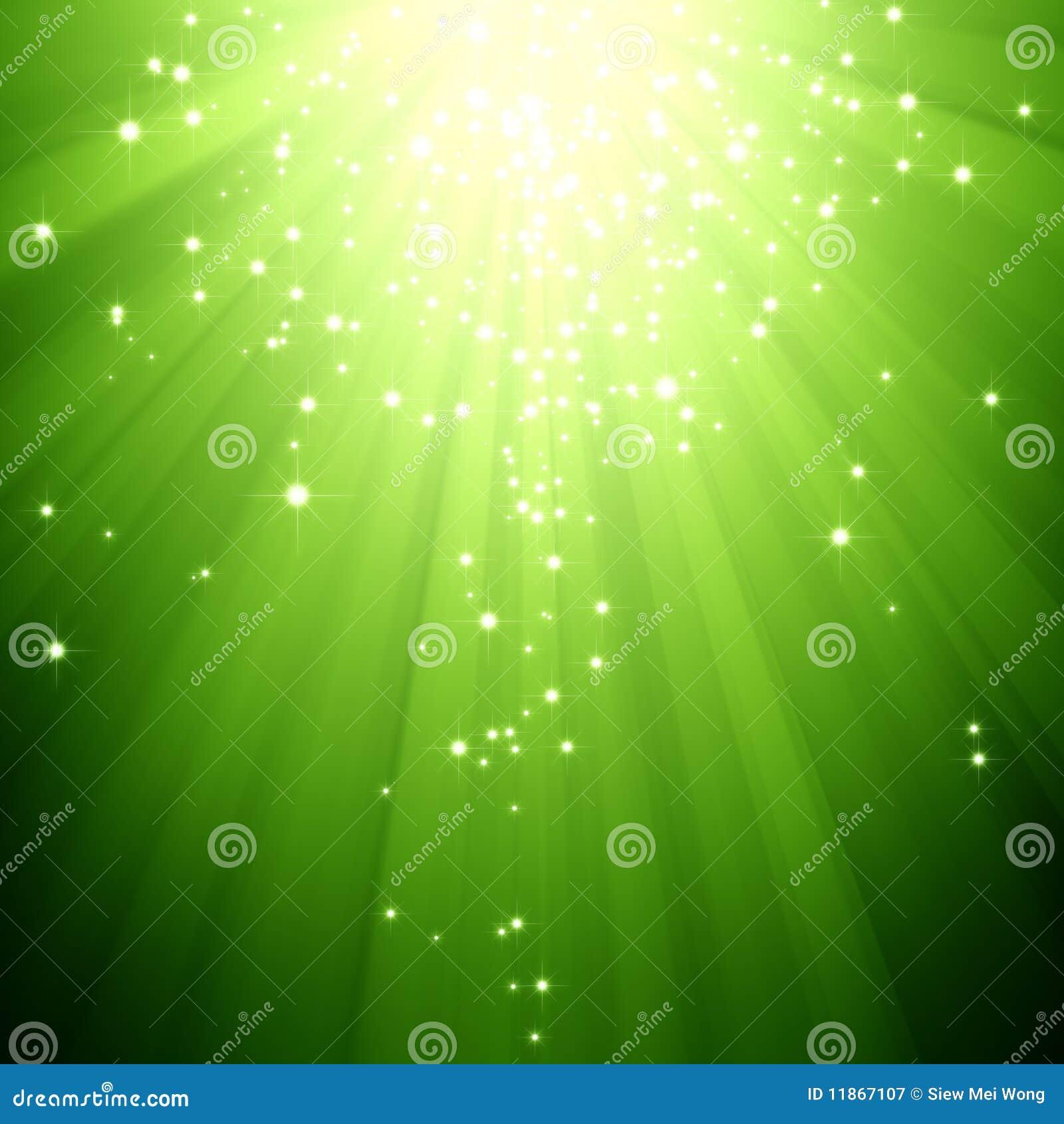 Étoiles de scintillement descendant sur l éclat de feu vert