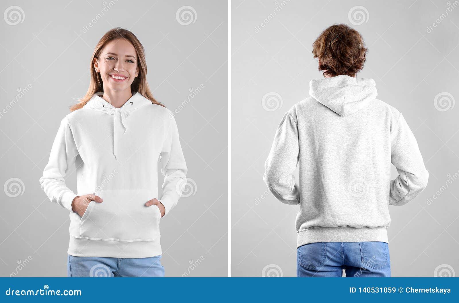 Люди в пустых свитерах hoodie на светлых взглядах предпосылки, передних и задних
