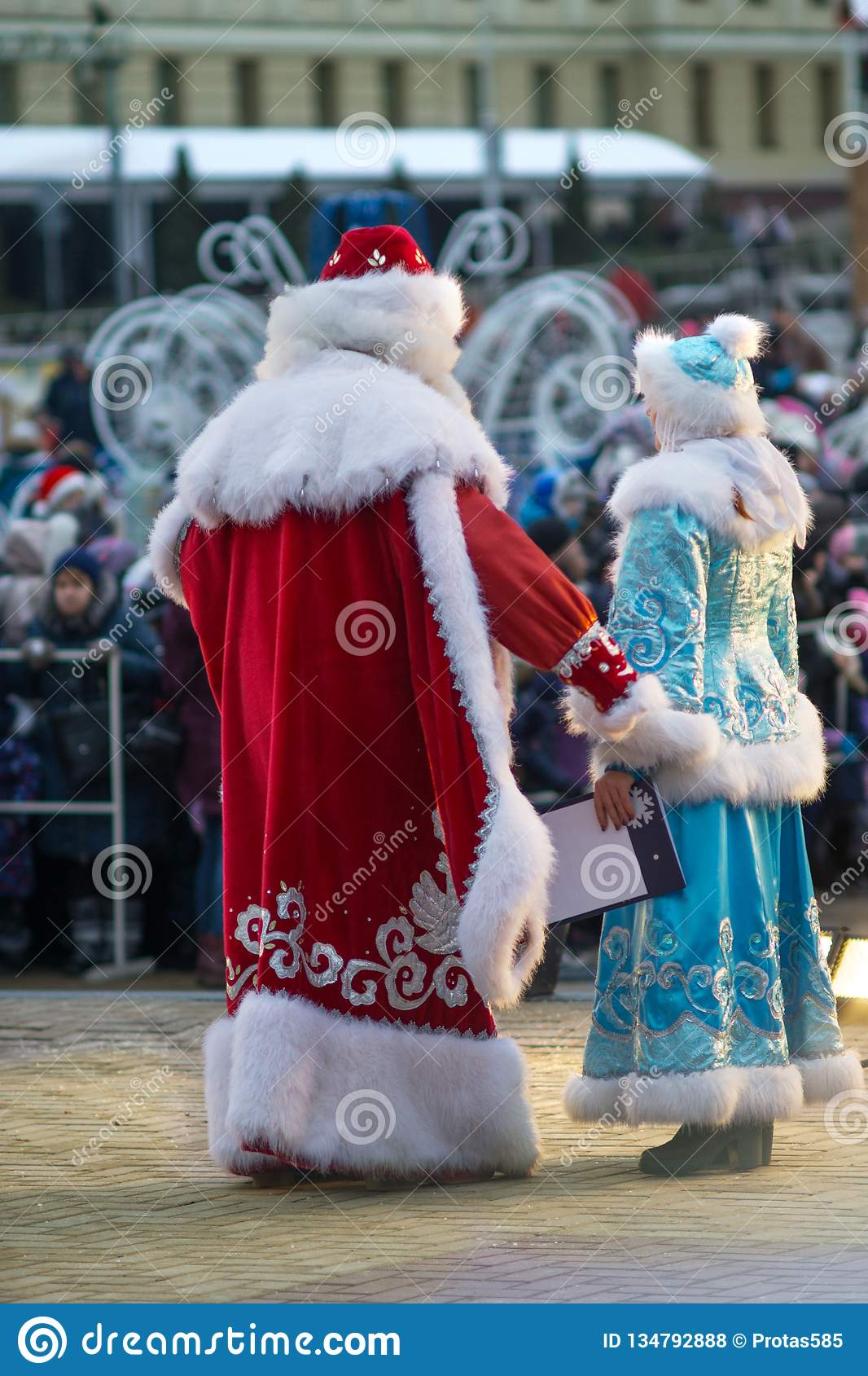 Father Frost and the Snow Maiden congratulate people merry Christmas