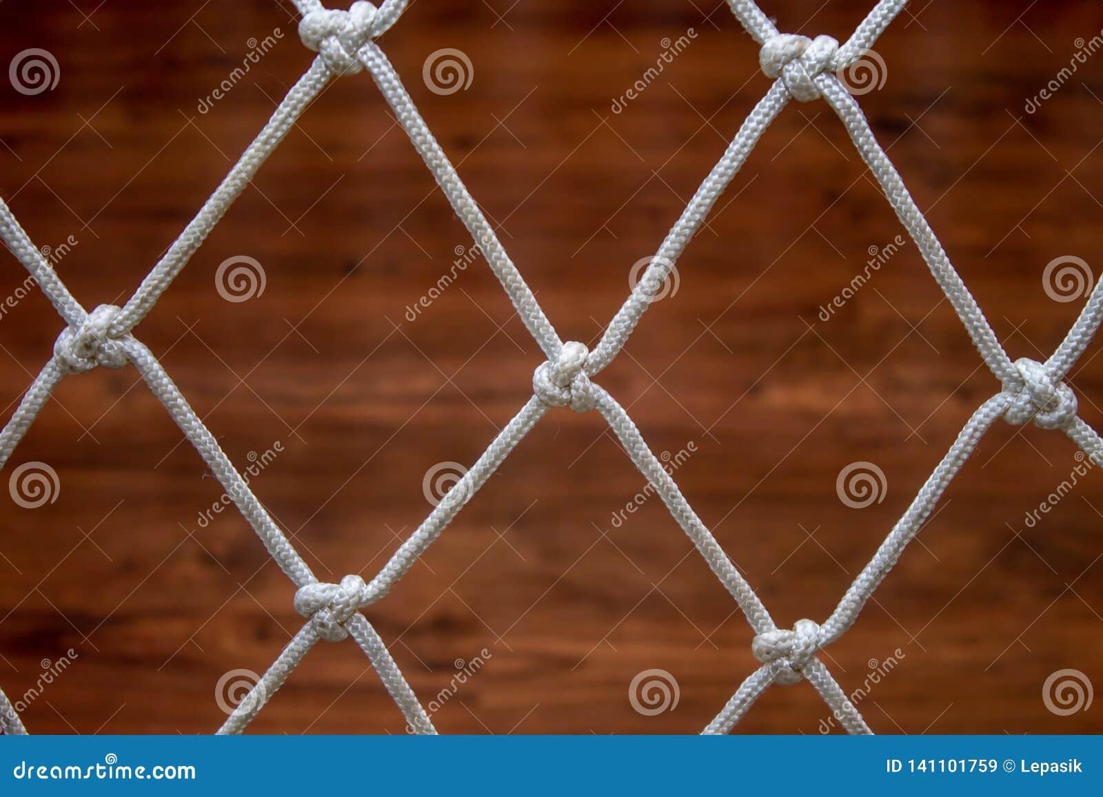 Сеть веревочки от гамака, против деревянного ламината