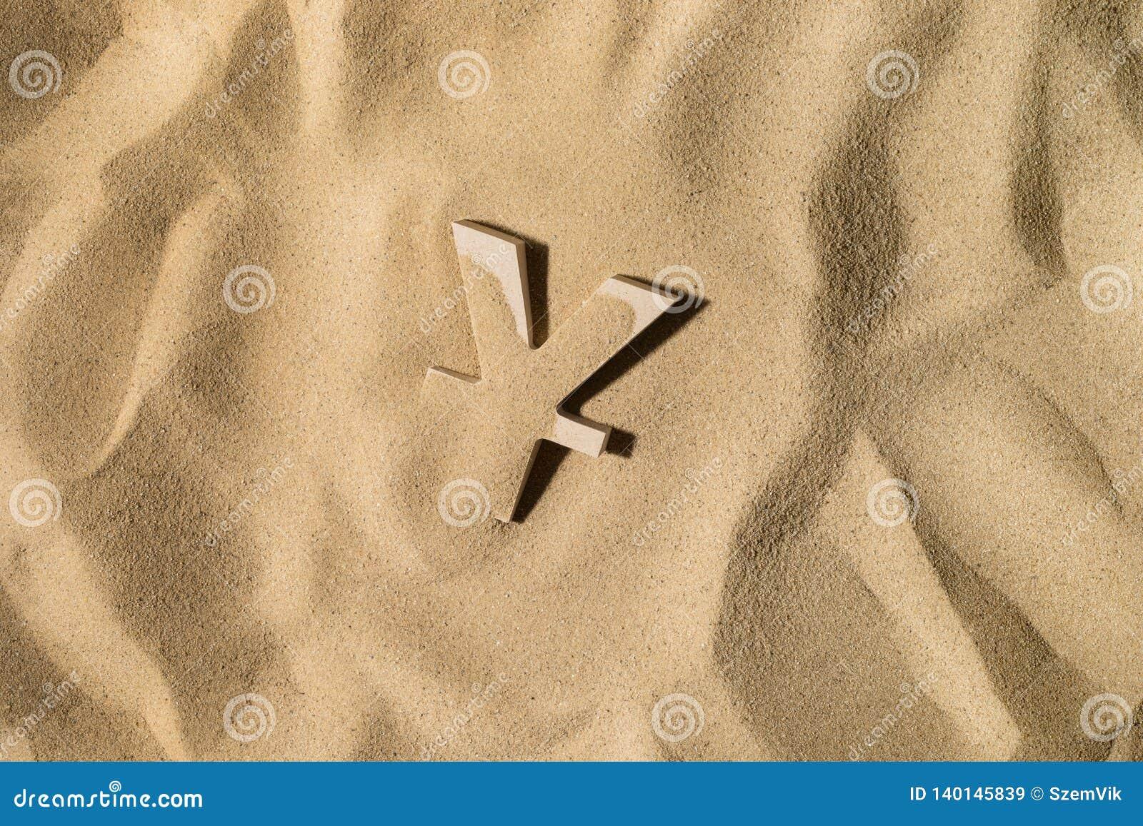 Символ иен под песком
