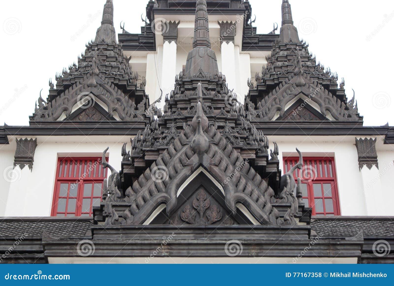 Сarved oriental buildings in Bangkok temple