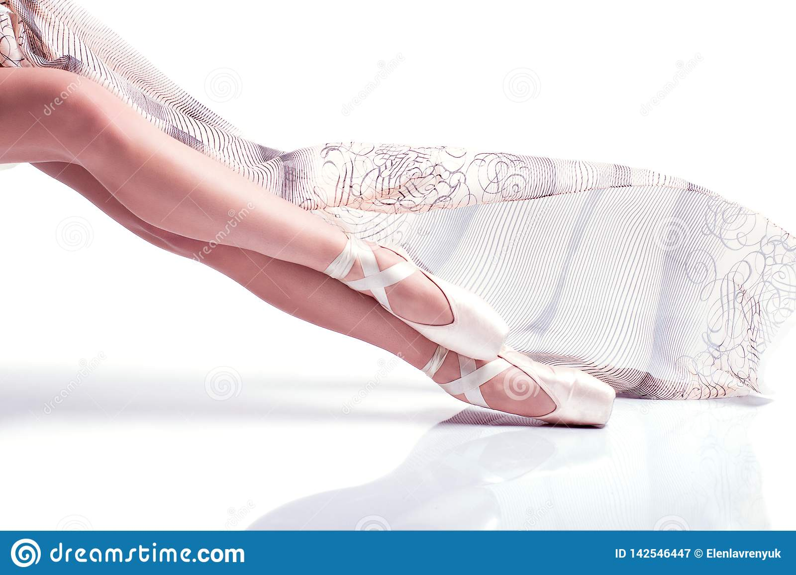 Ballerina feet pointe and with silk scarf on white background