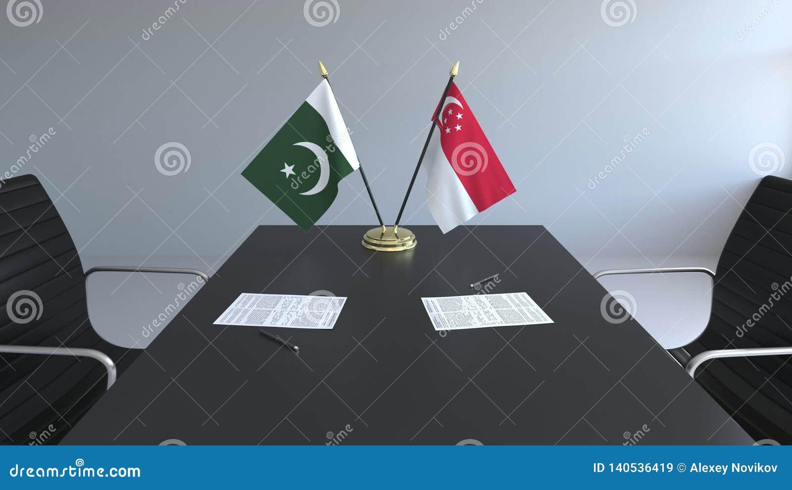 Флаги Пакистана и Сингапура и бумаги на таблице Переговоры и подписание международного соглашения схематическо
