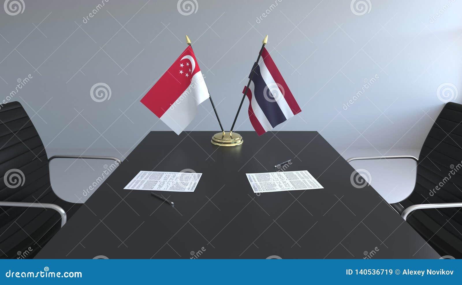 Флаги Сингапура и Таиланда и бумаги на таблице Переговоры и подписание международного соглашения схематическо