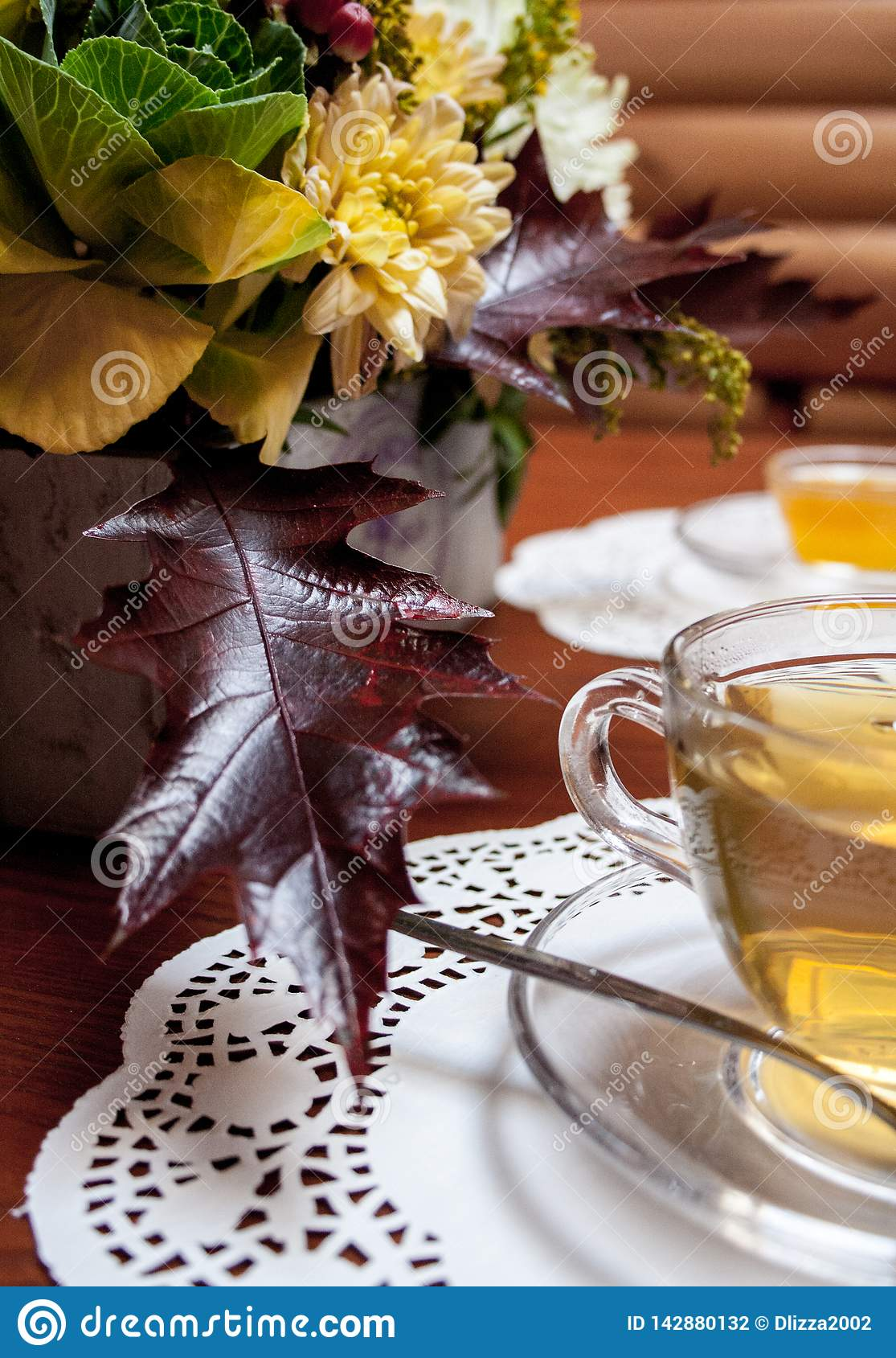 Сup of tea and flowers on table