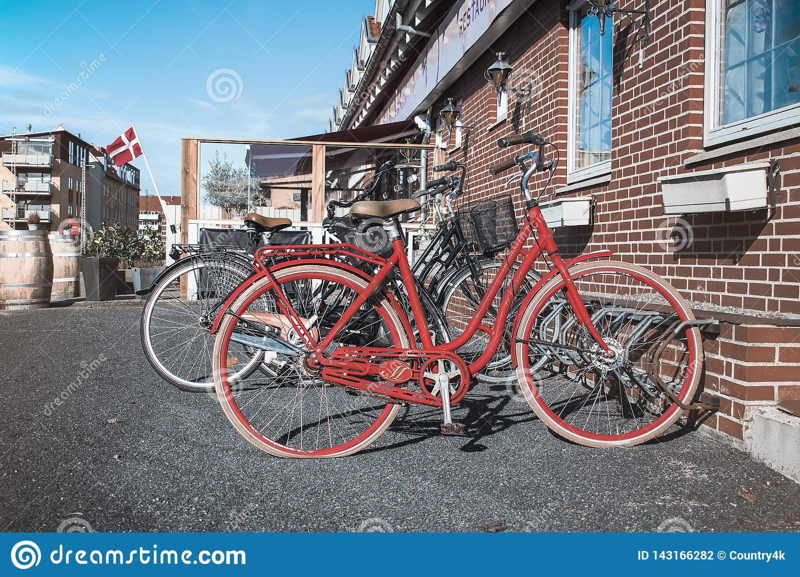 Retro red bicycle on the street near the cafe