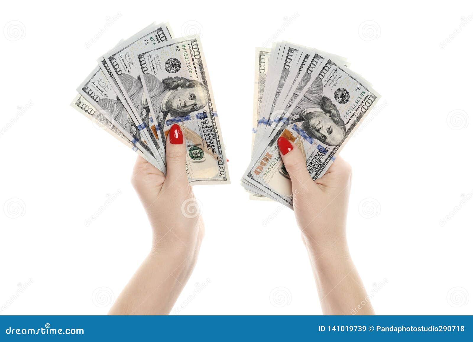 Рука при деньги изолированные на белой предпосылке