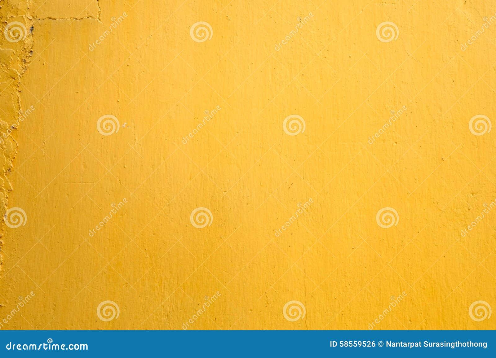 Żółty farby betonowej ściany tekstury tło