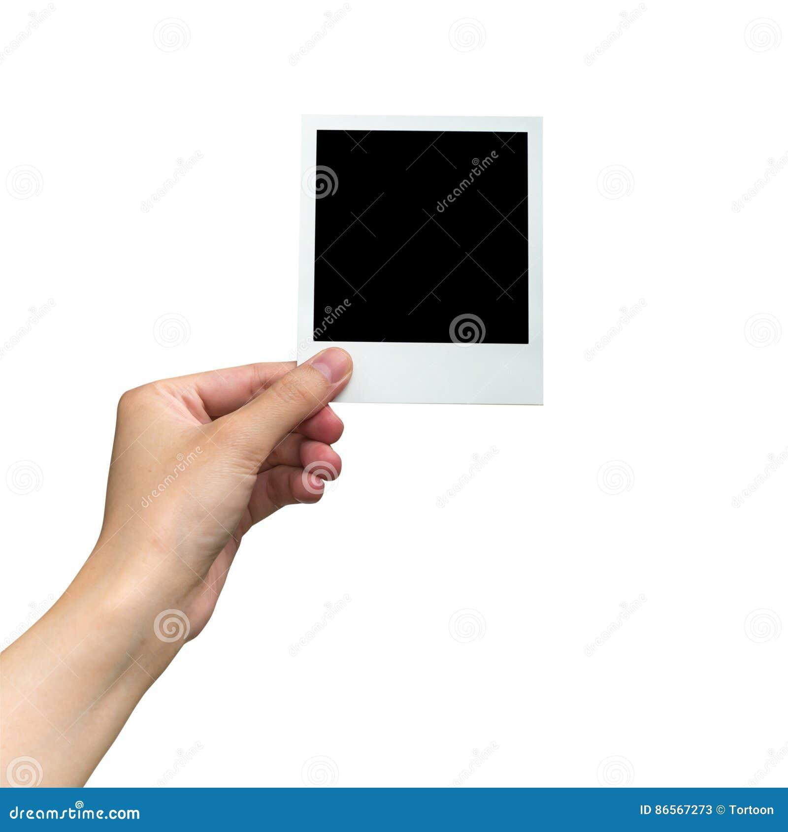 Übergeben Sie das Halten des Fotorahmens auf lokalisiertem Weiß mit Beschneidungspfad