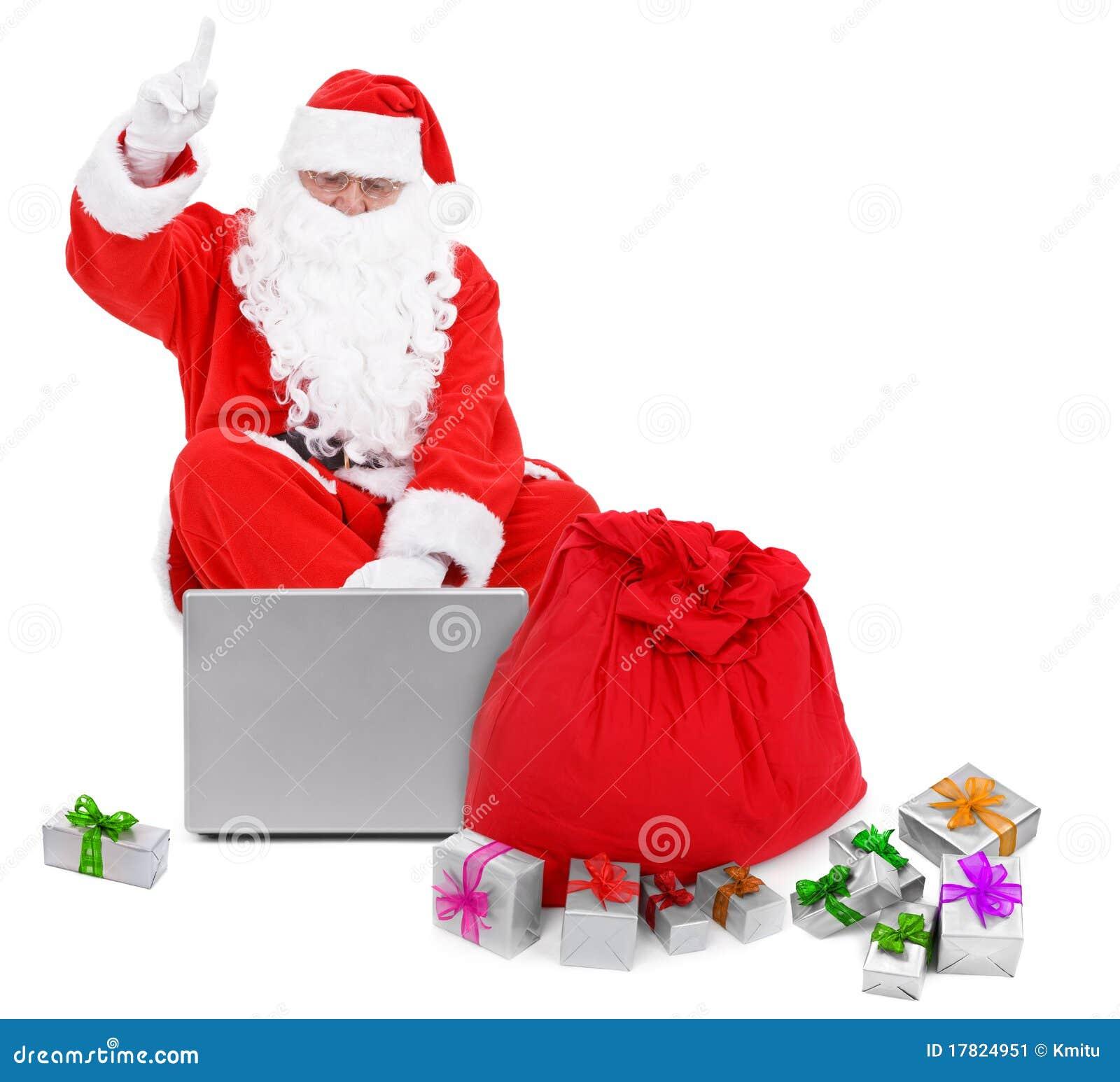 berraschter weihnachtsmann mit laptop und geschenken. Black Bedroom Furniture Sets. Home Design Ideas