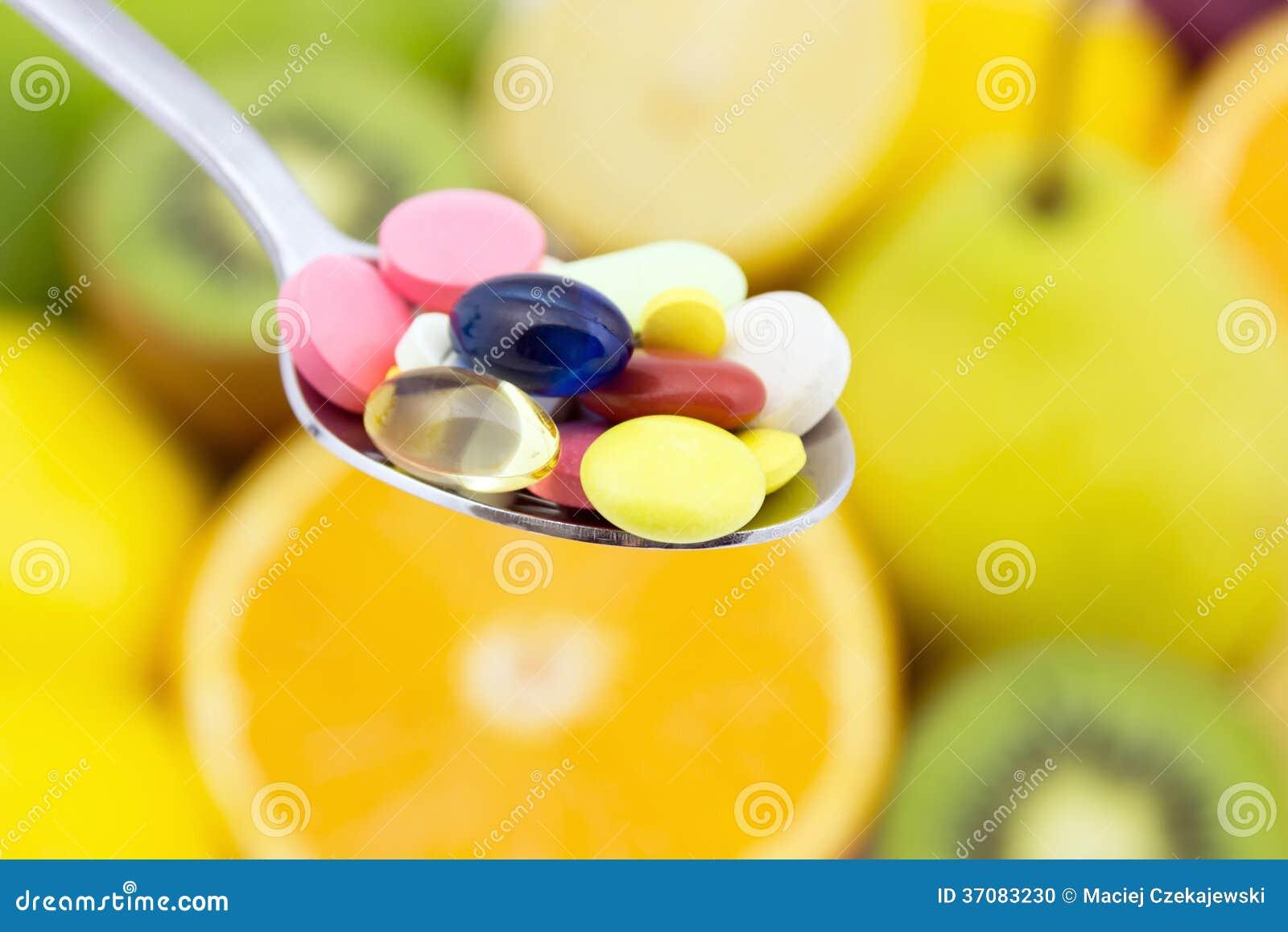 Download Łyżkowy Pełny Kolorowe Pigułki Zdjęcie Stock - Obraz złożonej z kolorowy, zbliżenie: 37083230