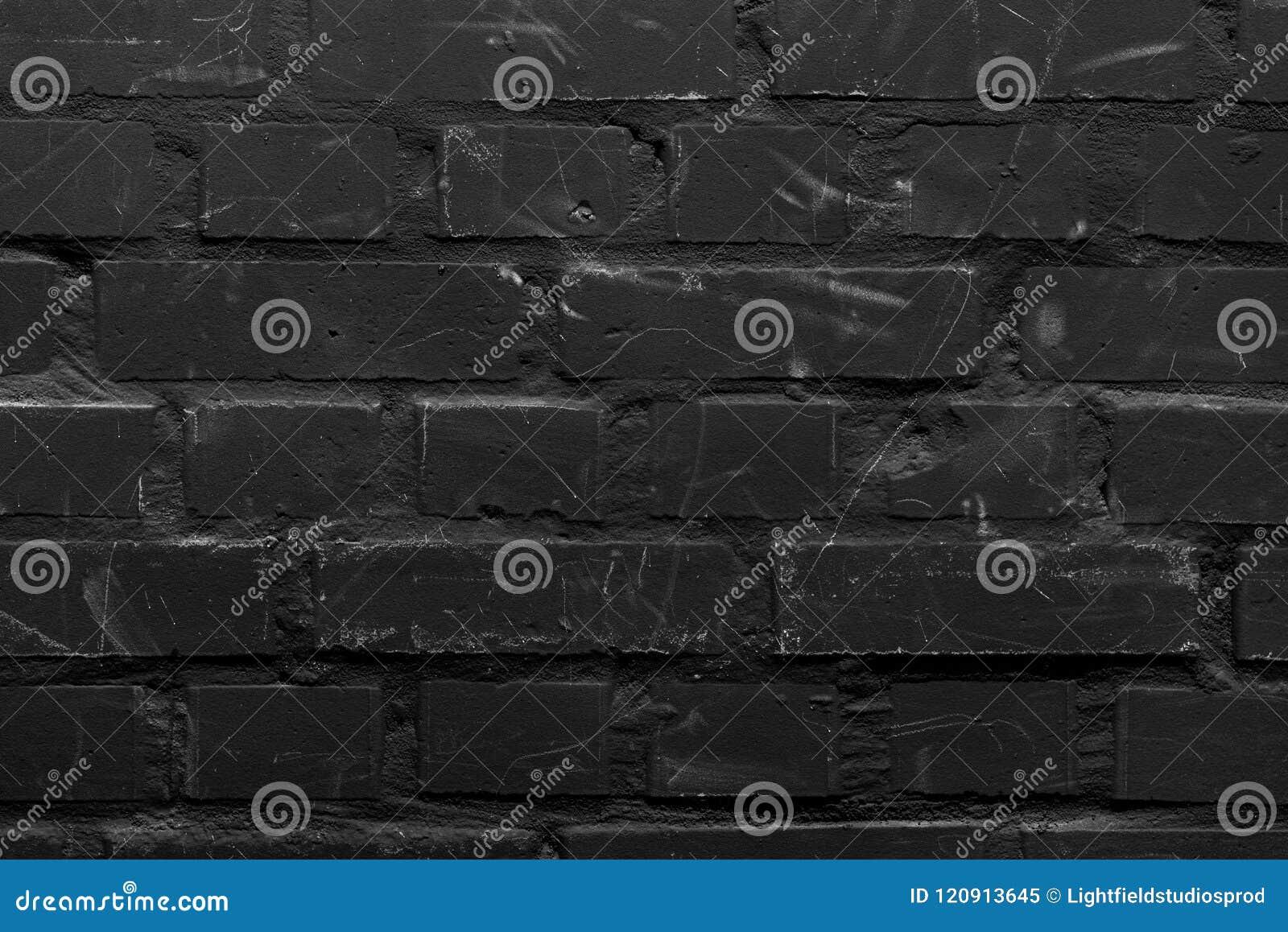 Ściana z cegieł malujący