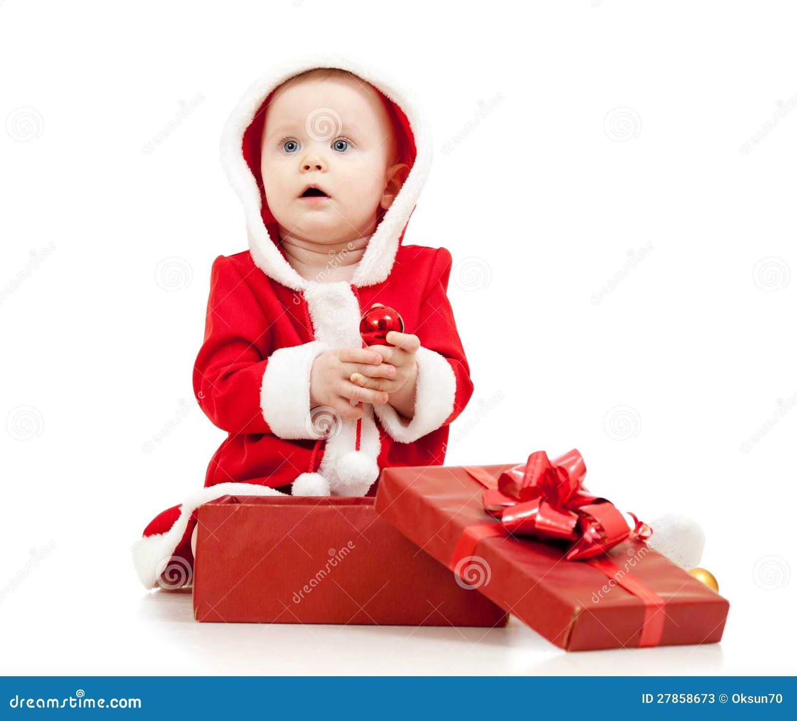 Święty Mikołaj dziewczynka z prezenta pudełkiem na biel