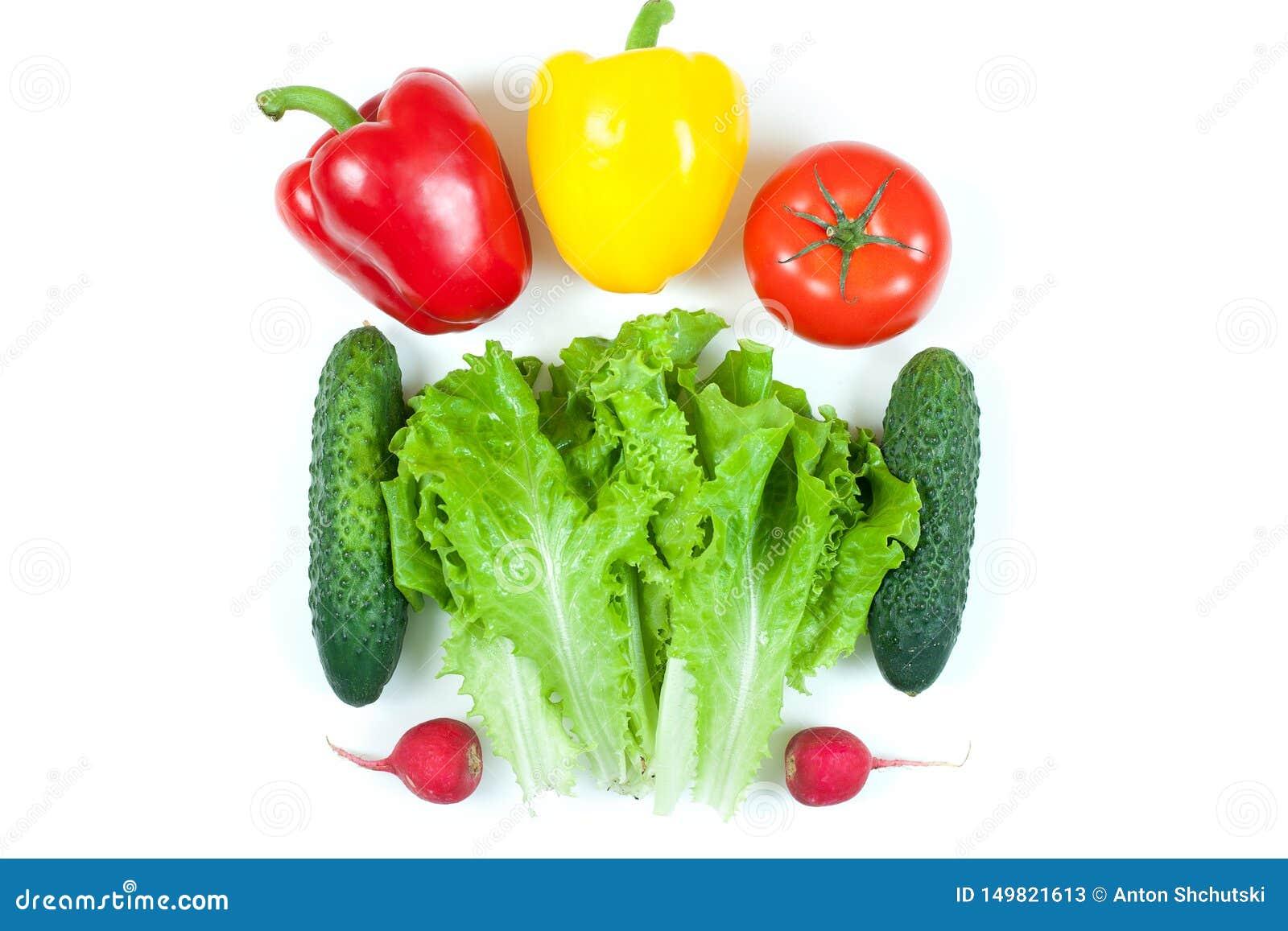 Świezi kolorowi organicznie warzywa chwytali z góry odgórnego widok, mieszkania nieatutowy odosobniony na białym tle Układ z bezp