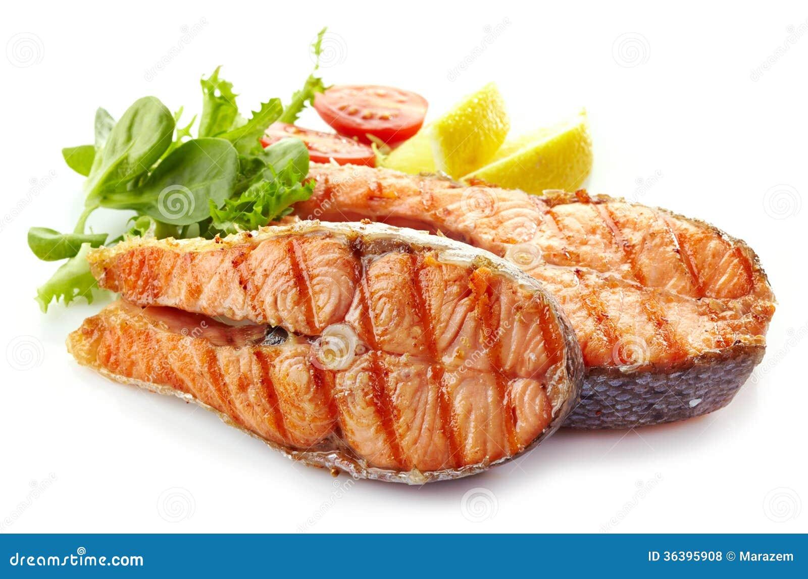 Świezi piec na grillu łososiowego stku plasterki