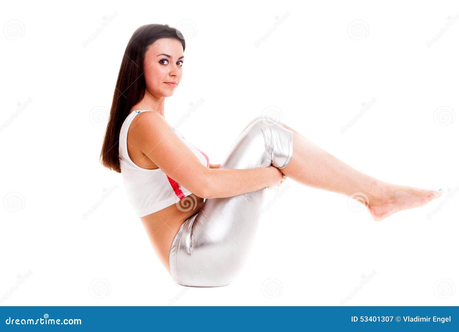 女孩在白色背景健身房锻炼隔绝的pilatos瑜伽