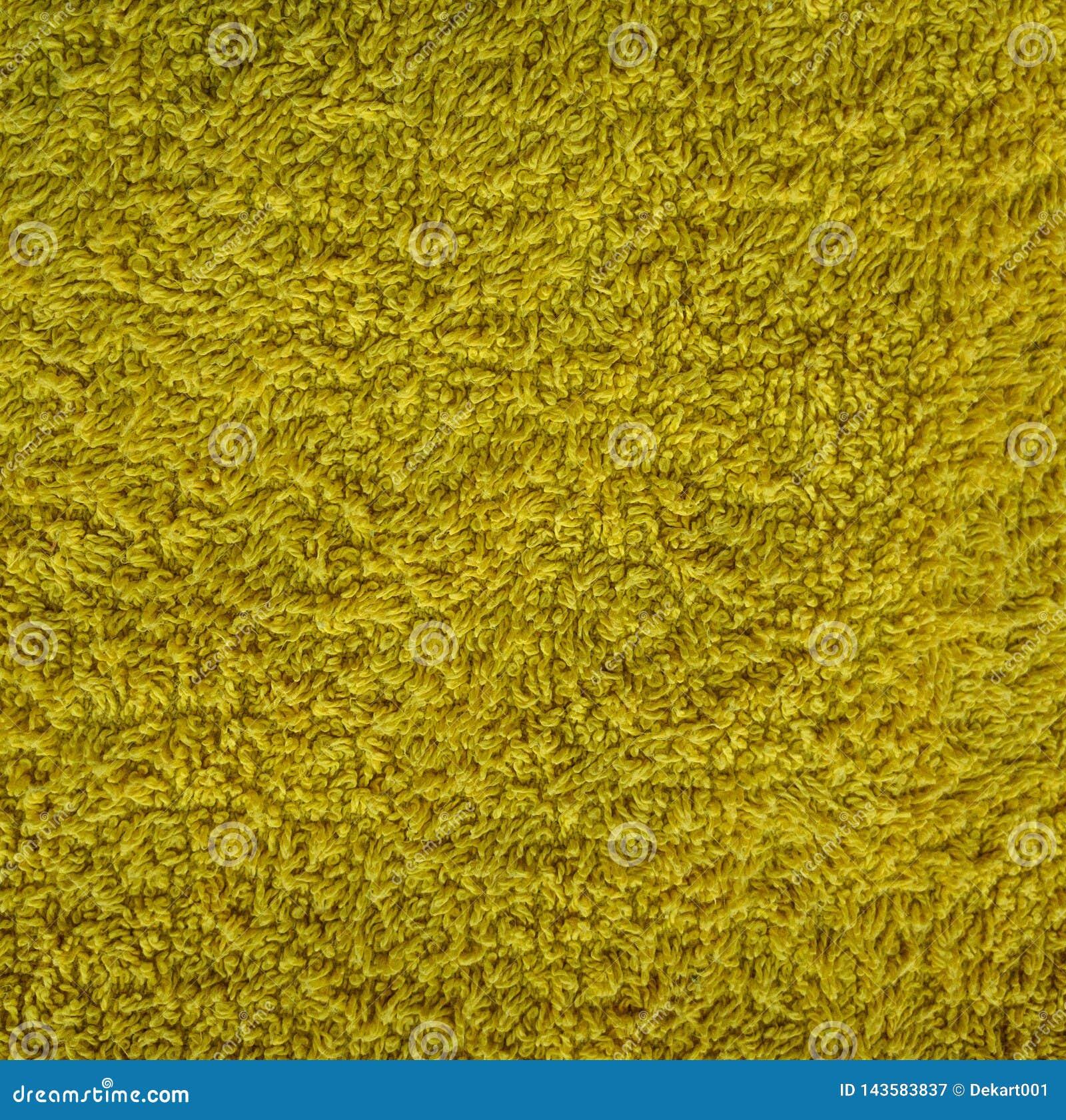 Żółty dywanowy materiał z luźnymi niciami, abstrakcjonistyczna tło tekstura
