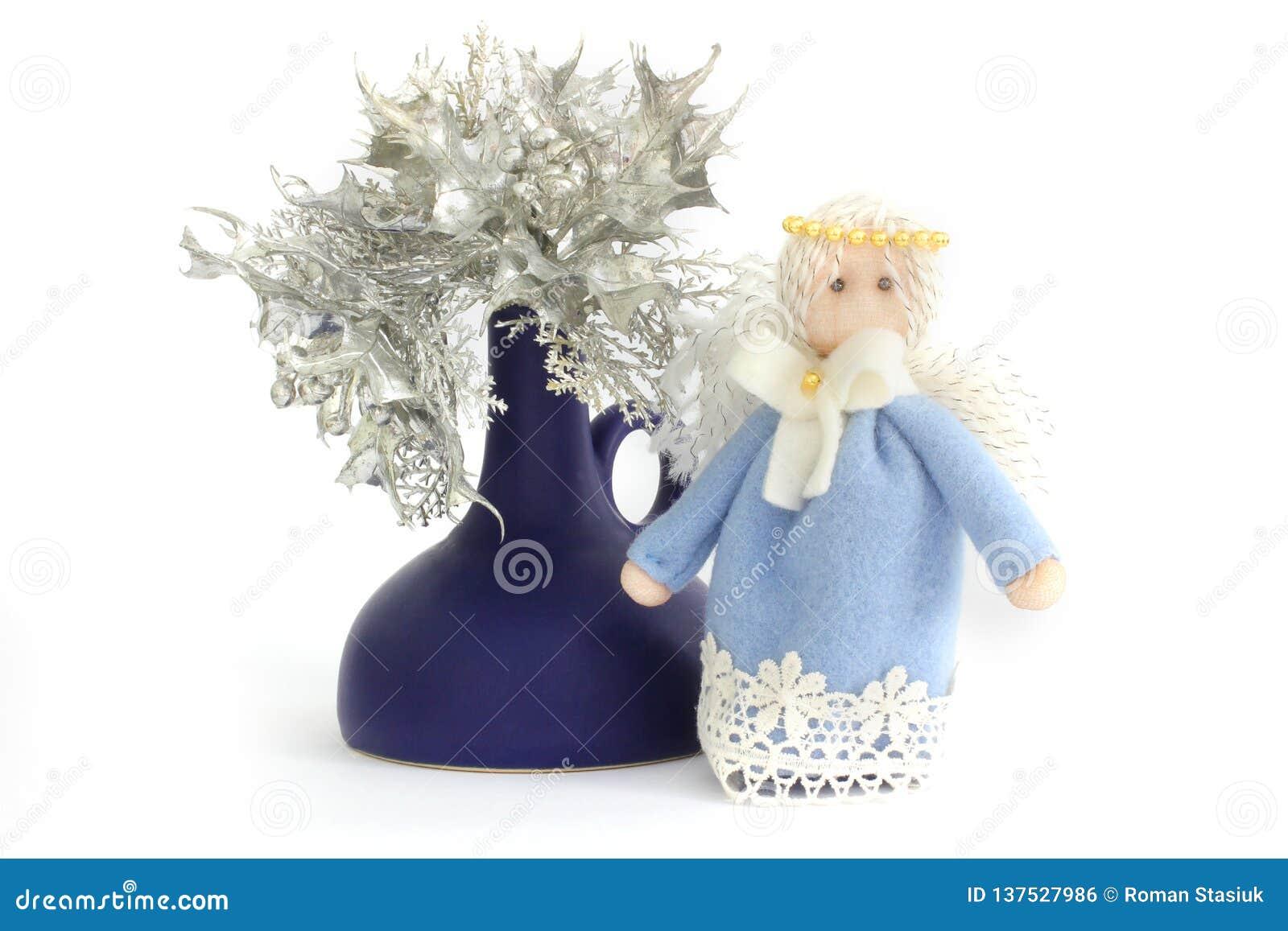 Άγγελος Χριστουγέννων και λουλούδια Χριστουγέννων