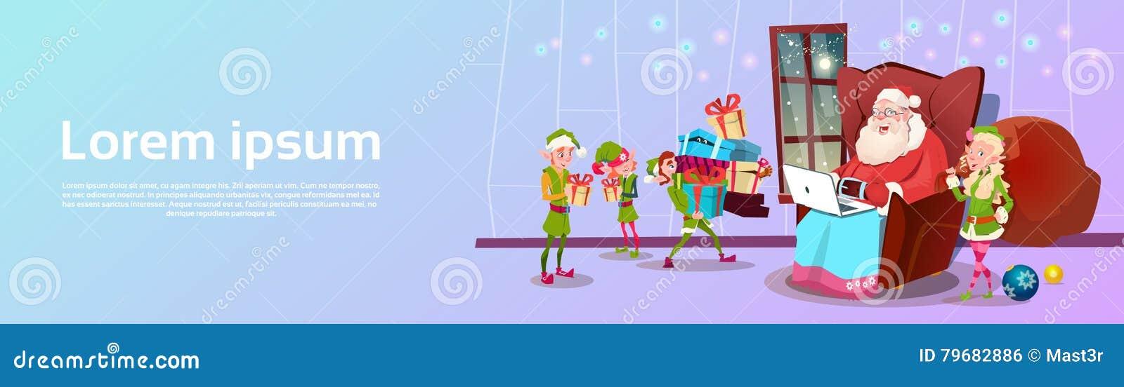 Άγιος Βασίλης που χρησιμοποιεί την πράσινη ομάδα αρωγών νεραιδών lap-top με το παρόν έμβλημα Χαρούμενα Χριστούγεννας καλής χρονιά