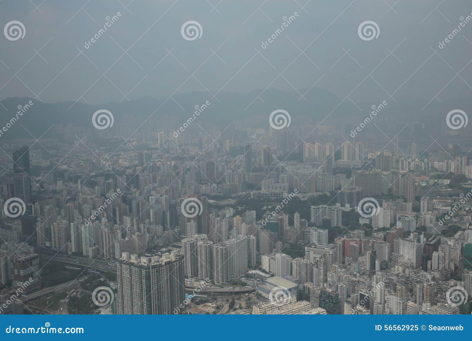 Download Άποψη Kowloon από το διεθνή κεντρικό ουρανοξύστη εμπορίου - Στοκ Εικόνα - εικόνα από νεφελώδης, γυαλί: 56562925