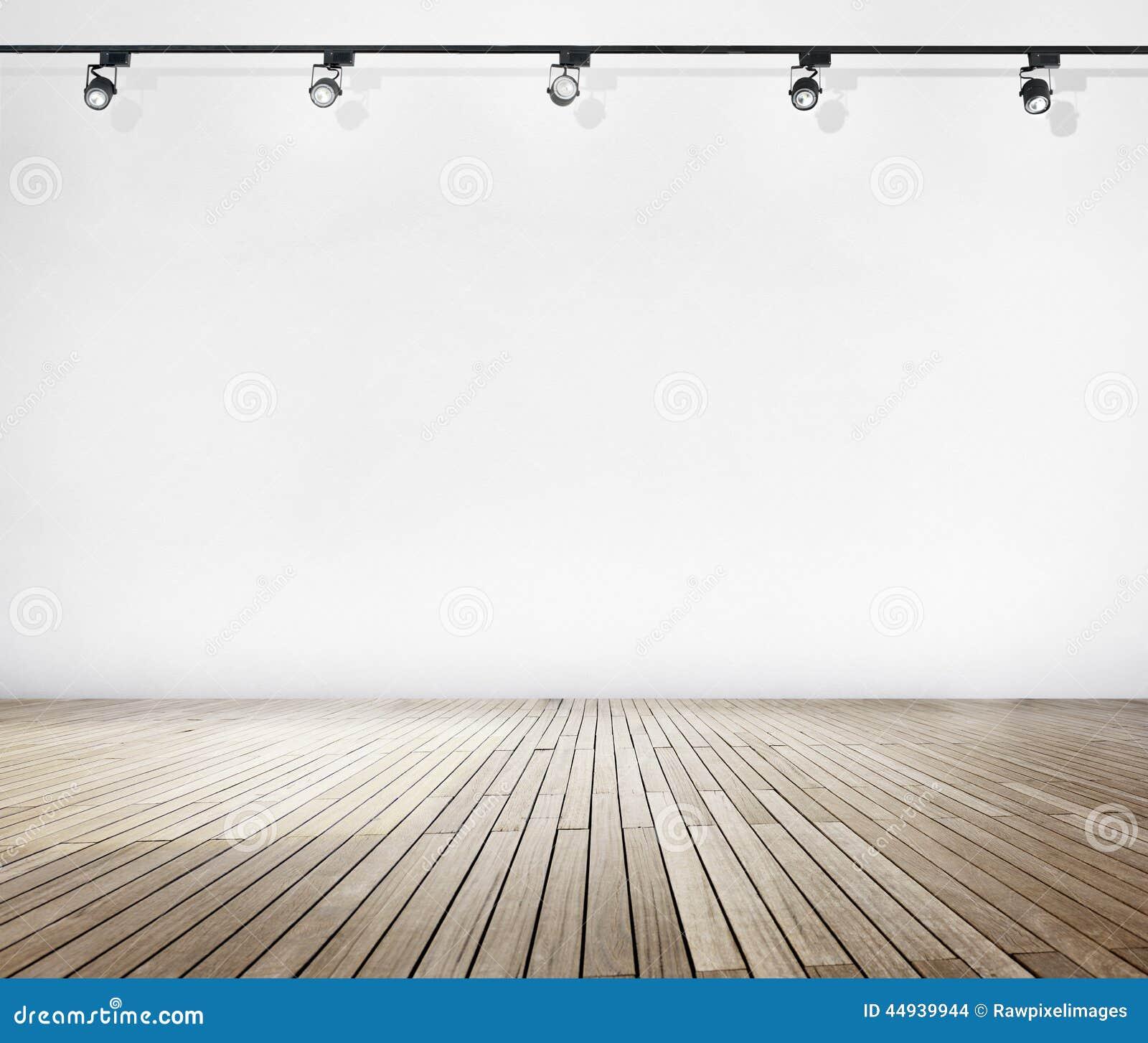 Άσπρος τοίχος και ξύλινο πάτωμα με τα επίκεντρα