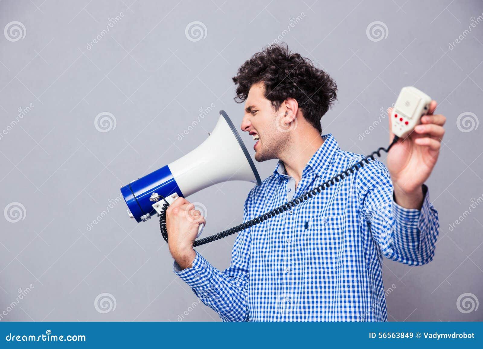 Download Άτομο που κατευθύνει Megaphone σε την Στοκ Εικόνα - εικόνα από γραφείο, προσωπικότητα: 56563849