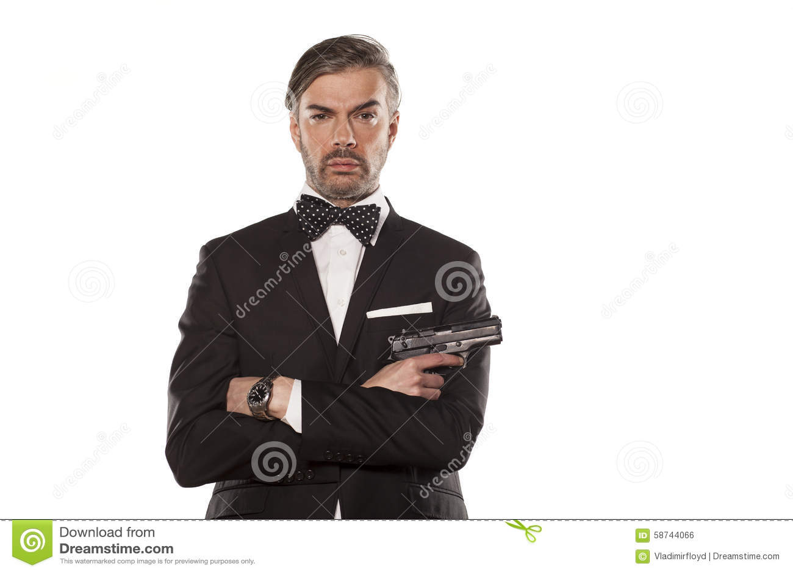 a62bea58ab8a Άτομο σε ένα κοστούμι με ένα πυροβόλο όπλο Στοκ Εικόνες - εικόνα από ...