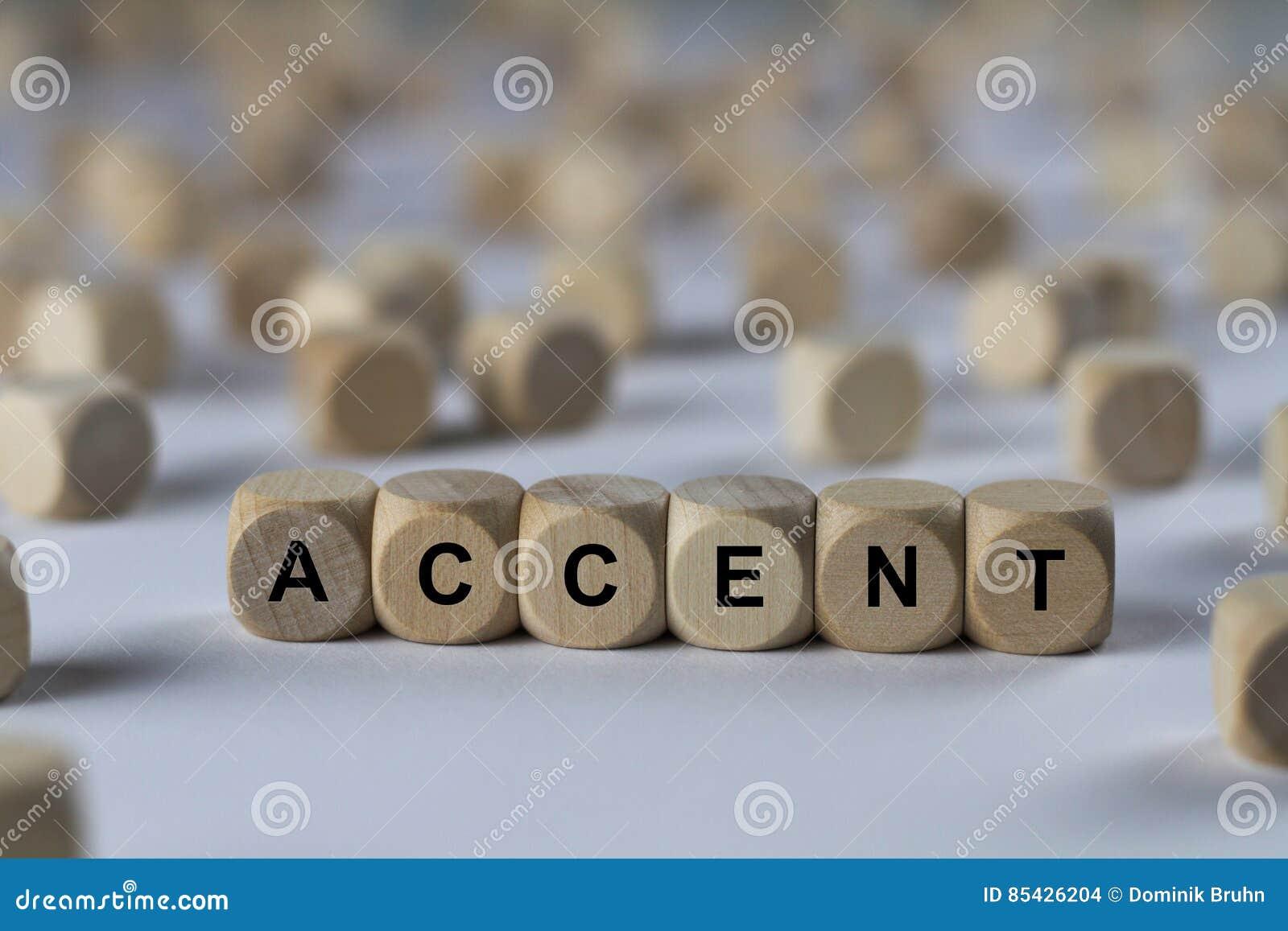 Έμφαση - κύβος με τις επιστολές, σημάδι με τους ξύλινους κύβους