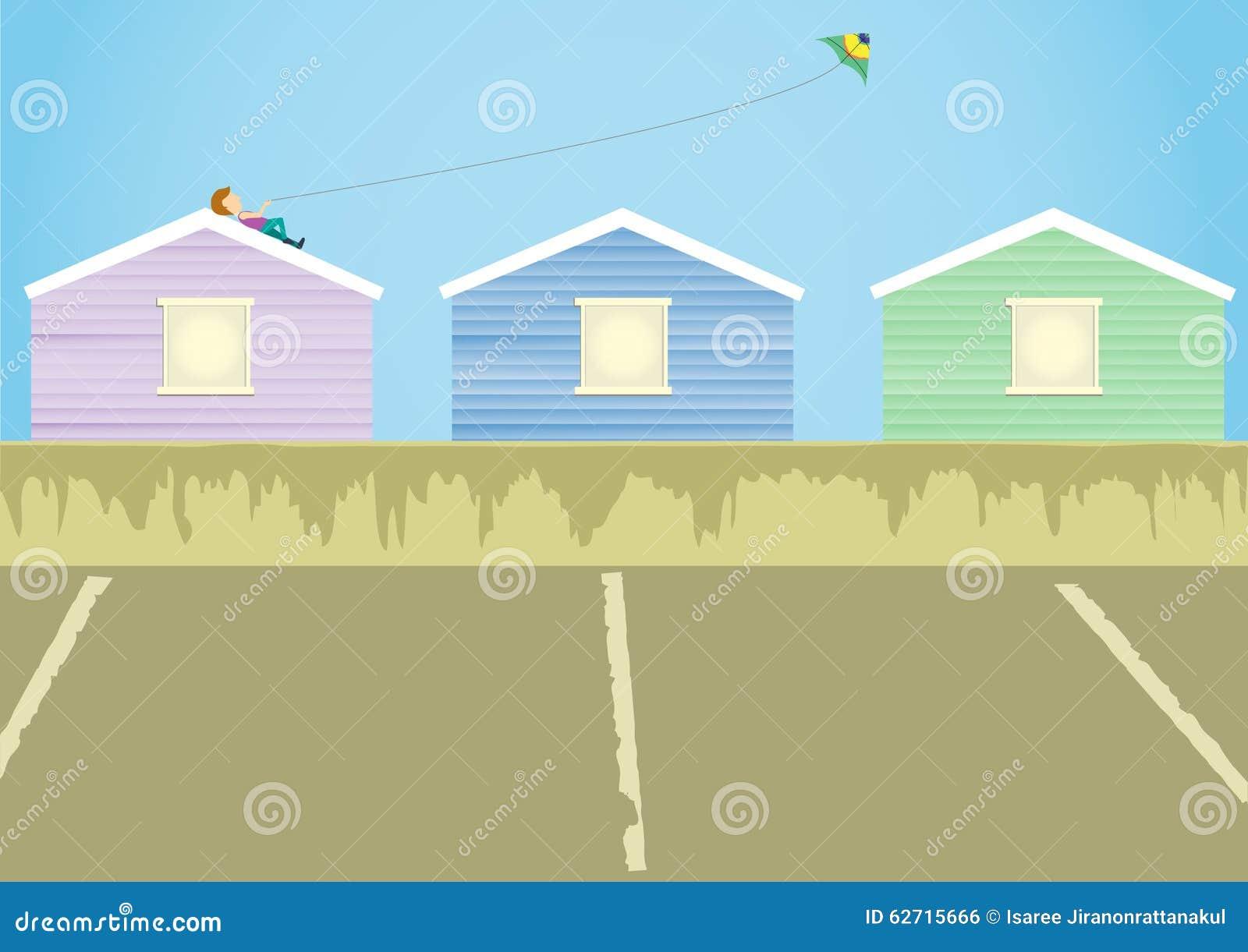ένας ικτίνος παιχνιδιού αγοριών στη στέγη