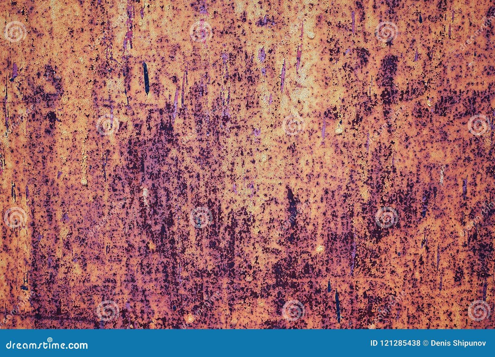 Ένα παλαιό χρωματισμένο φύλλο του σιδήρου που καλύπτεται με το αφηρημένο υπόβαθρο σκουριάς