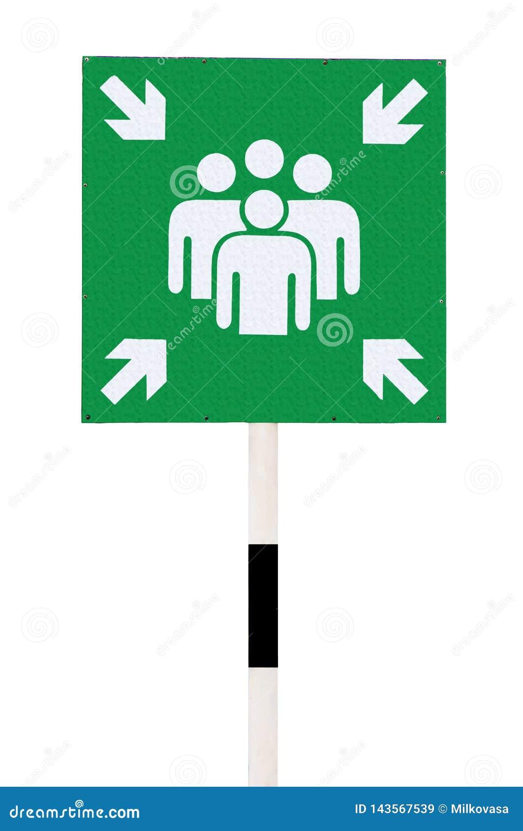 Ένα πράσινο σημάδι σημείου συνελεύσεων έκτακτης ανάγκης