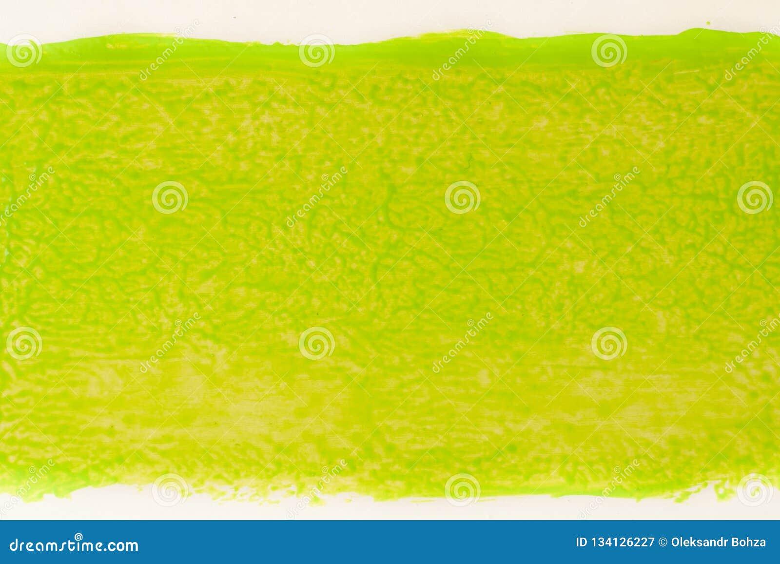 Ίχνος του πράσινου χρώματος από το ρόλο για τη ζωγραφική στον τοίχο Έννοια επισκευής