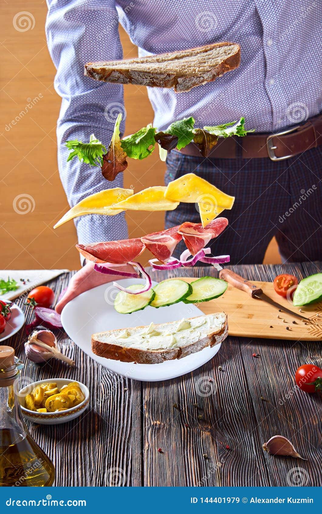 Ακόμα ζωή με ένα πετώντας σάντουιτς κατά την διάρκεια της υποβολής