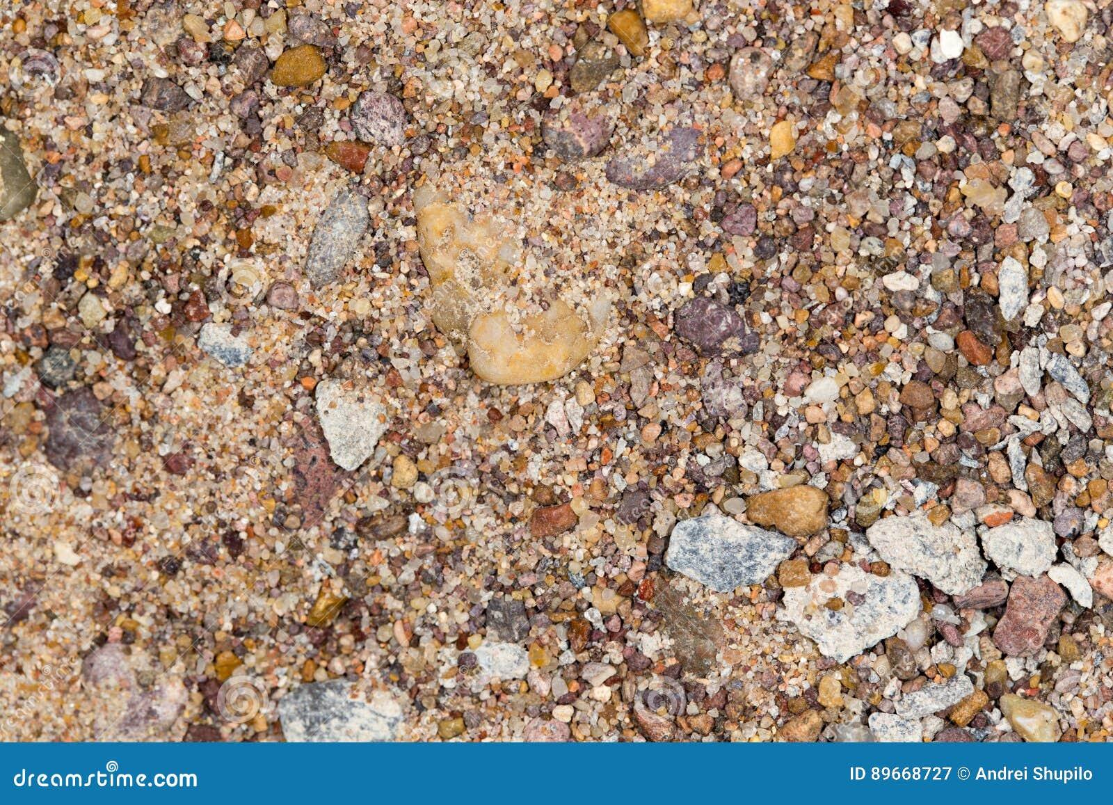 Αμμοχάλικο με την άμμο ως υπόβαθρο
