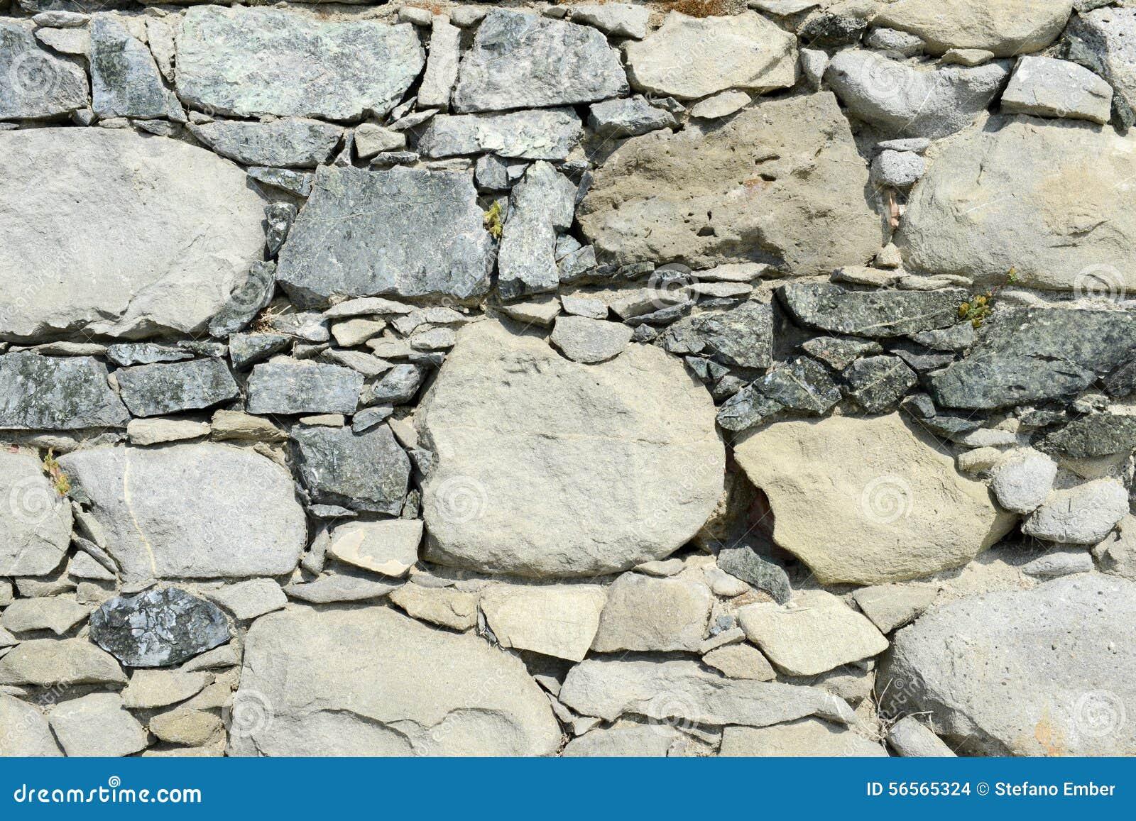 Download Ανασκόπηση του τοίχου πετρών Στοκ Εικόνες - εικόνα από ζωηρόχρωμος, antiquate: 56565324