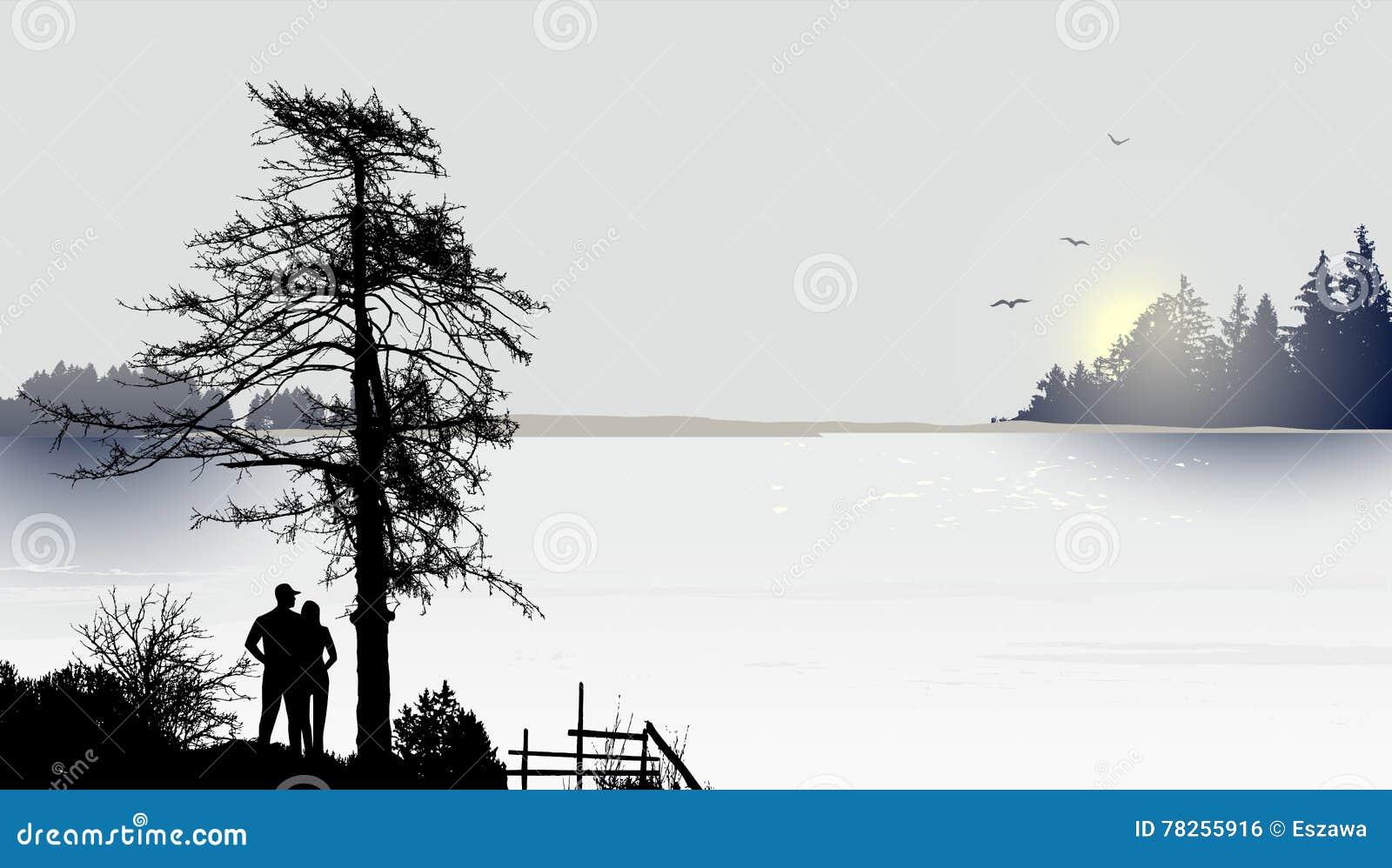 Ανατολή ή ηλιοβασίλεμα στη λίμνη και ένα ζεύγος