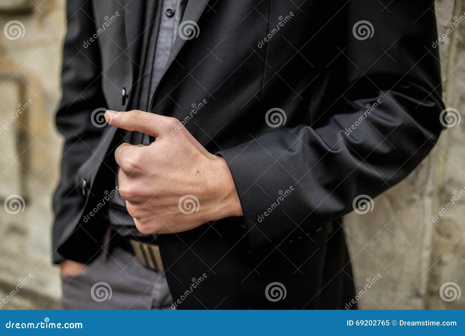 Ανθρώπινα χέρι και σακάκι