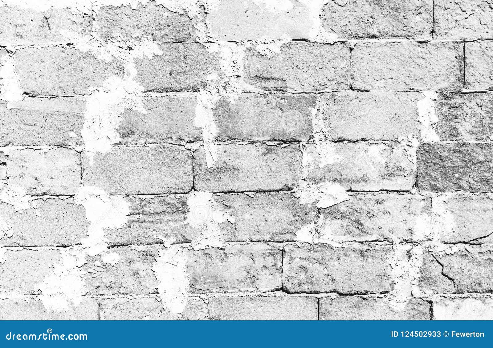 Απλή βρώμικη άσπρη επιφάνεια τουβλότοιχος με το υπερβολικό τσιμέντο που ενώνει το μεγάλο τσιμεντένιων ογκόλιθων υπόβαθρο σύστασης