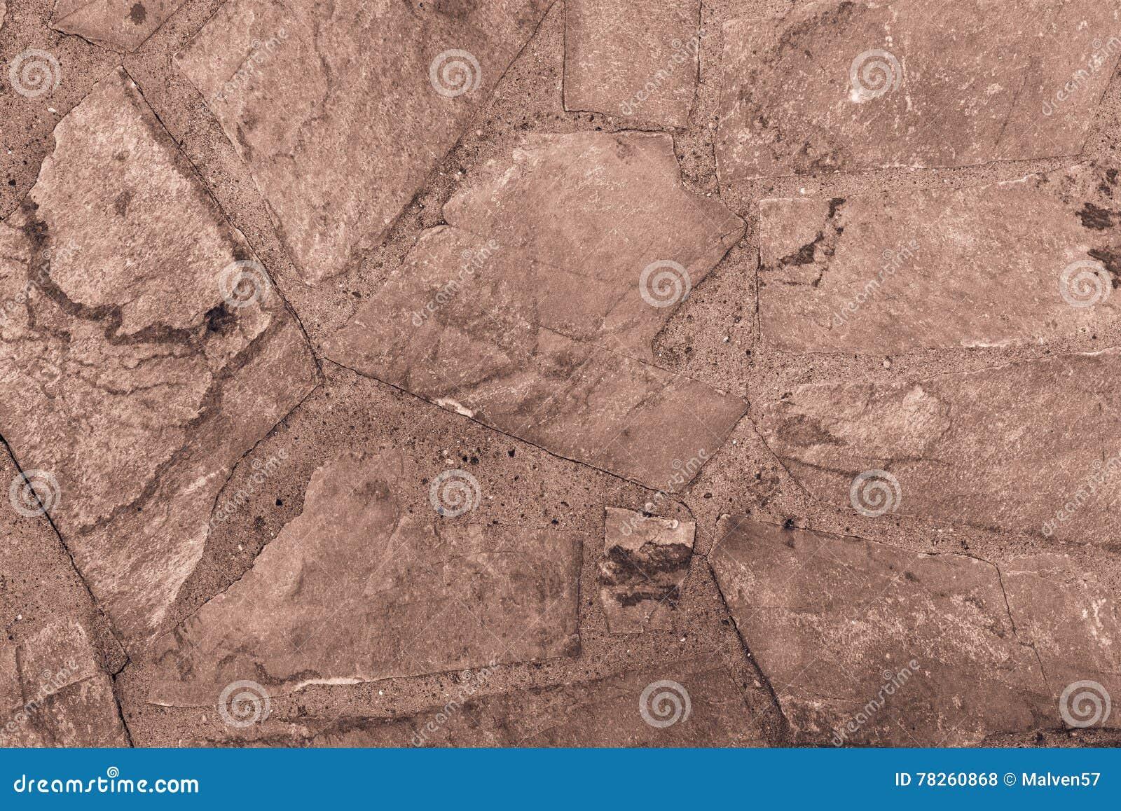 Αφηρημένο κατασκευασμένο υπόβαθρο ενός καφετιού χρώματος κεραμιδιών πετρών