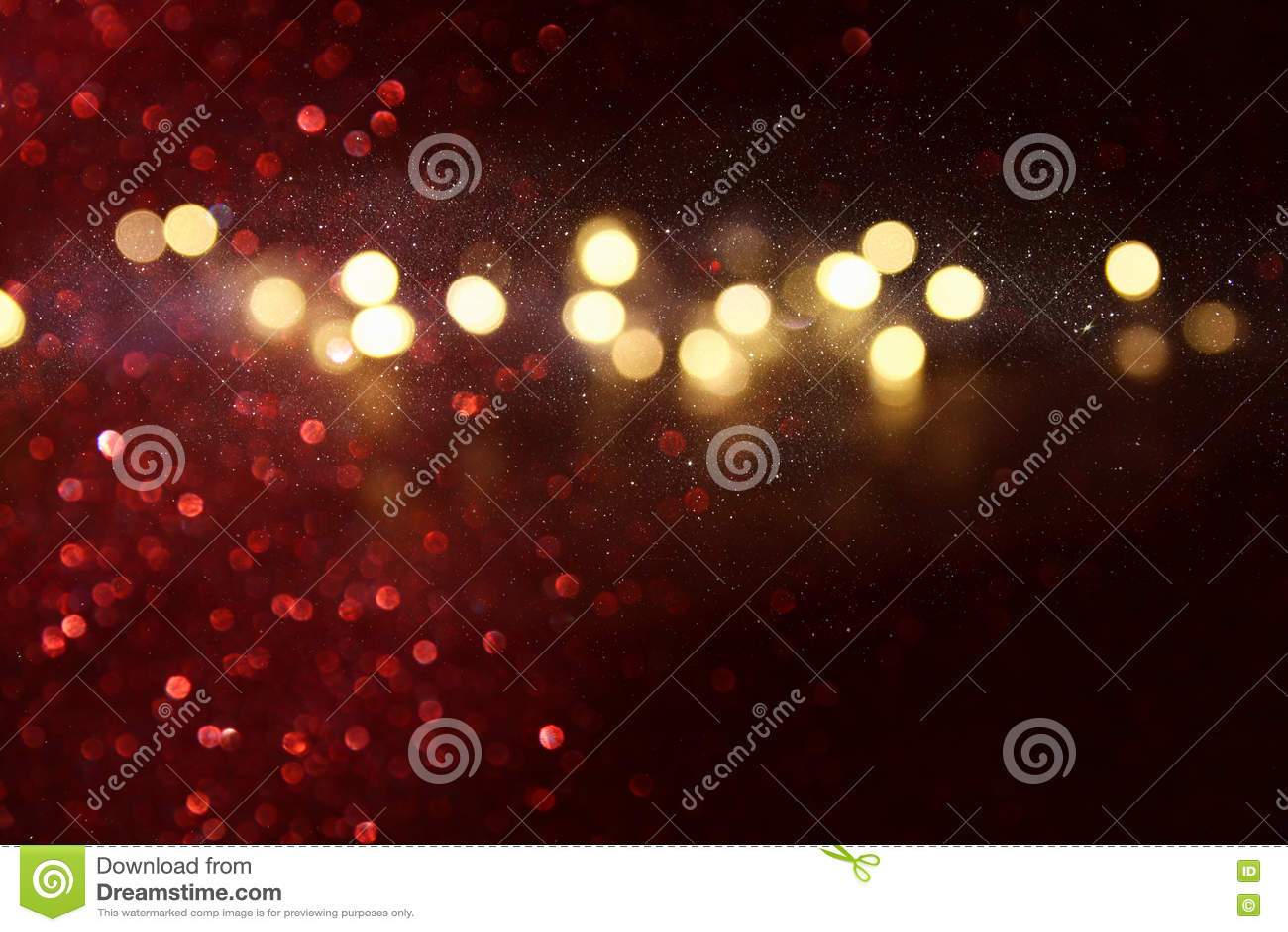 Αφηρημένο κόκκινο και χρυσό υπόβαθρο φω των Defocused