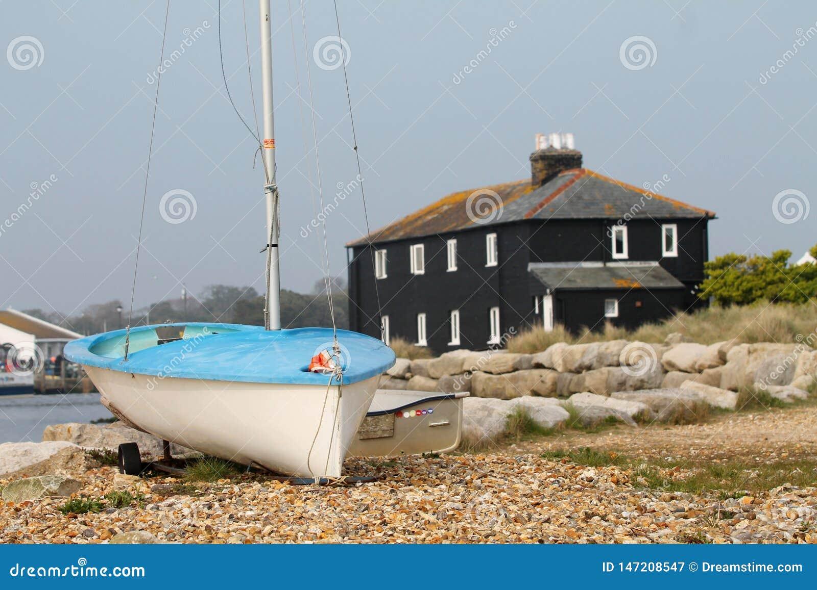 """Βάρκα με """"του μαύρου σπιτιού σε Mudeford, Dorset, UK"""