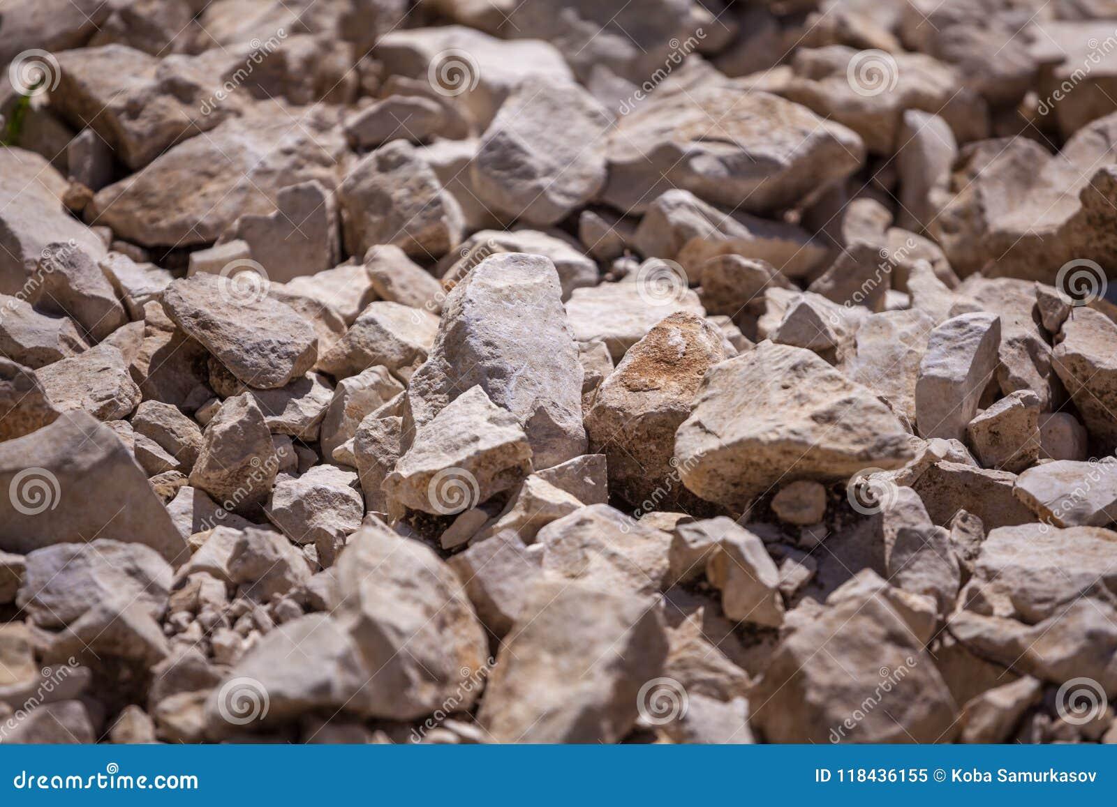 Βράχοι, μικρό βράχοι ή αμμοχάλικο που χρησιμοποιούνται για την οικοδόμηση των κτηρίων,