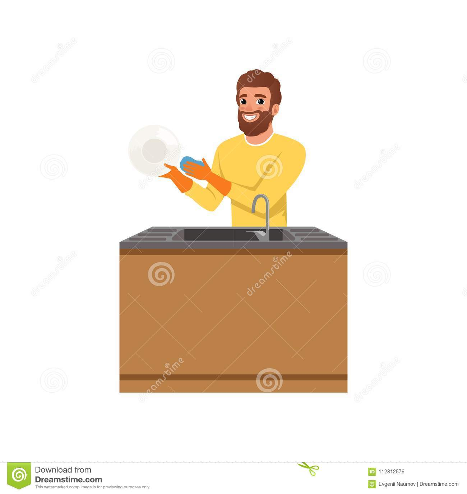 Γενειοφόρος τύπος στα πορτοκαλιά λαστιχένια γάντια που πλένουν το πιάτο με το σφουγγάρι Νεαρός άνδρας που κάνει τις οικιακές μικρ