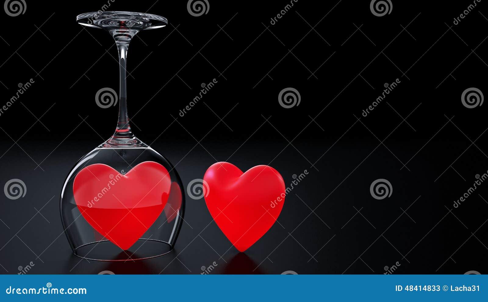 Γυαλί κρασιού με τις κόκκινες καρδιές την ημέρα του βαλεντίνου