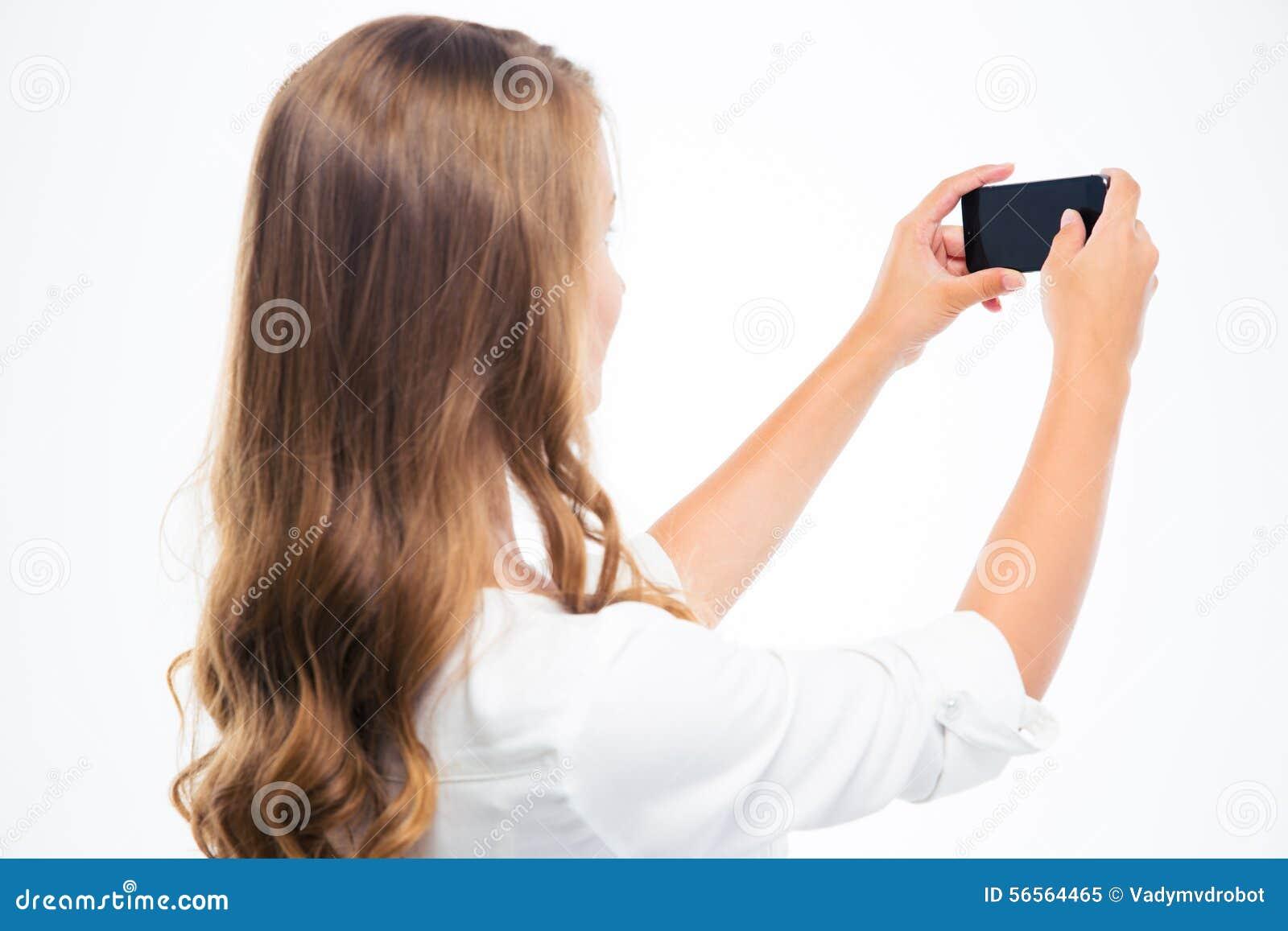 Download Γυναίκα που κάνει τη φωτογραφία στο Smartphone Στοκ Εικόνα - εικόνα από rear, εικόνα: 56564465
