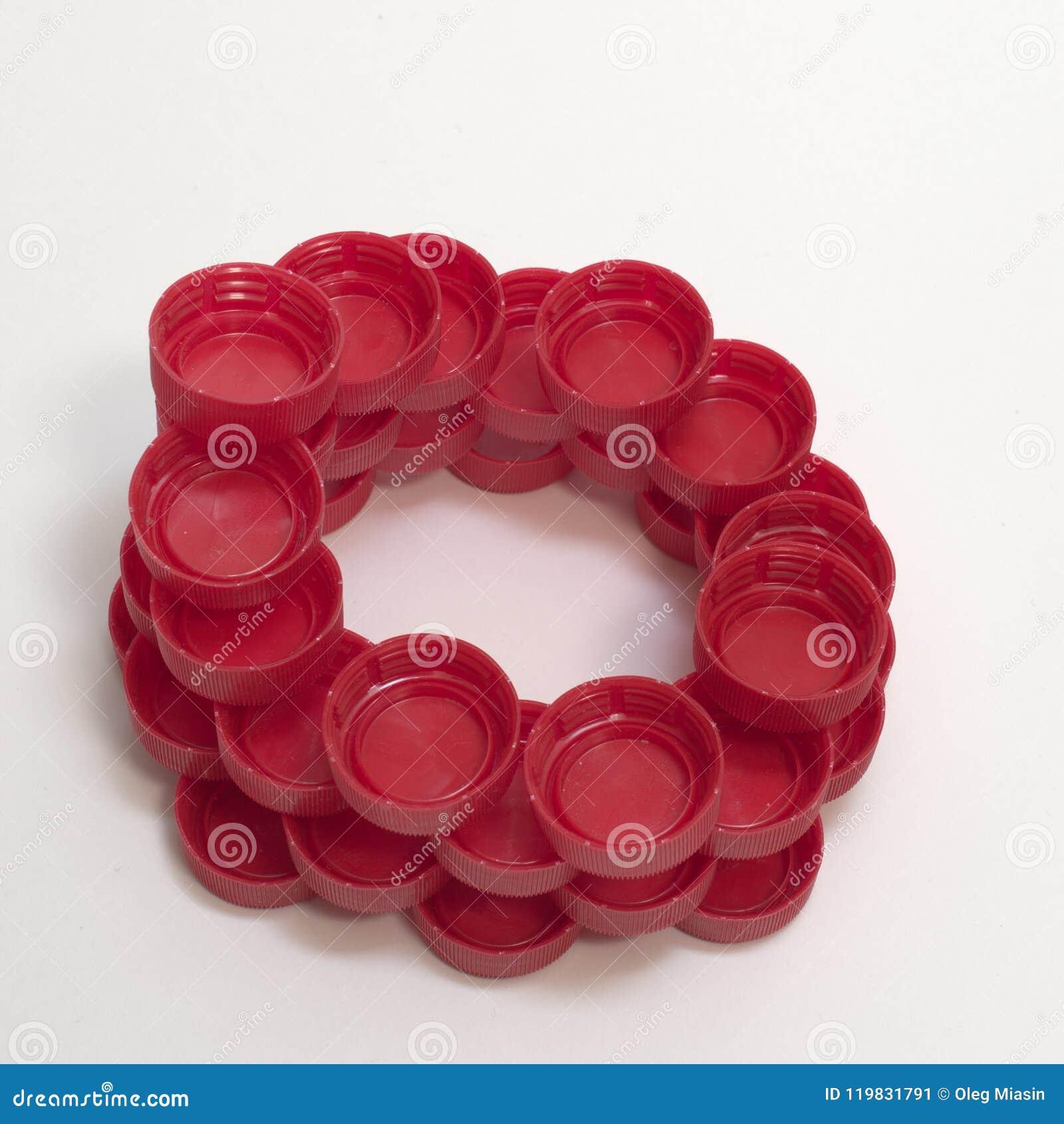 Δακτυλιοειδής περίπλοκος αριθμός φιαγμένος από κόκκινο ραβδωτό πλαστικό μπουκάλι γ